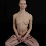 Nude yoga babe demonstrates extreme flexibility
