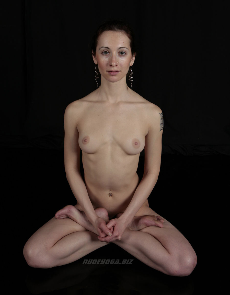 Nude yoga girl is posing